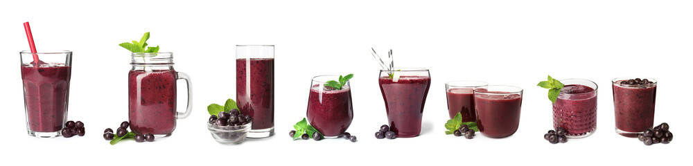Set of delicious acai juice in different glassware on white background