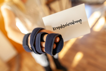 German medical certificate in a injured right hand. Krankschreibung means medical certificate Wall mural