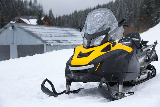 New stylish snowmobile parked outdoors. Winter recreation