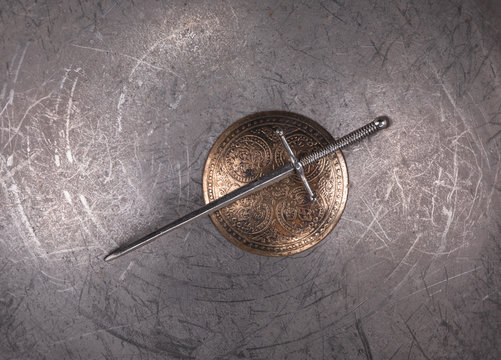 ancient shield and sword on a metal background