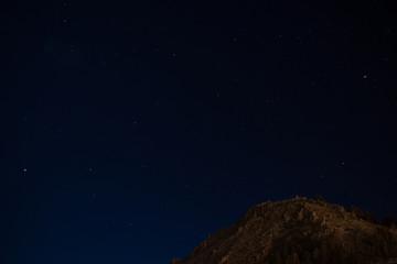 Stars and Calvario hill in a Titicaca Lake night