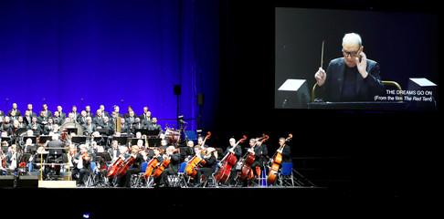 Italian composer Ennio Morricone conducts a concert in Berlin