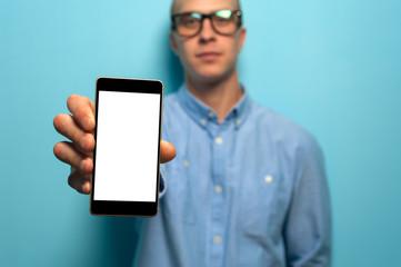 Hipster man holding smartphone