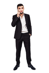 young bearded businessman or boss is seriously talking on the phone