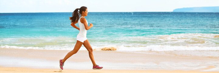 Runner girl training on beach - exercise workout fit Asian woman athlete jogging in sports wear and shoes banner panorama ocean background.