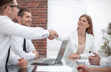 business handshake over the negotiating table