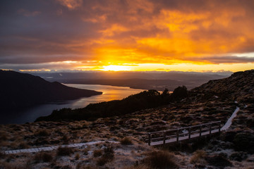 Amazing sunrise over the mountains and fiord in Fiordland national Park, South Island, New Zealand. Mountain scenery, beautiful outdoor background. Snow on the peaks. Kepler track, Luxmore Hut NZ