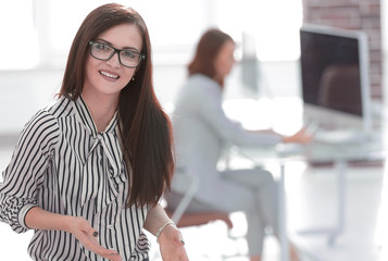 successful business woman on the background of her office
