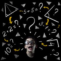 boy solve mathematics examples at the blackboard