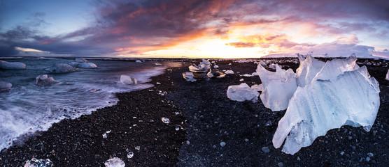 Beautiful sunset over famous Diamond beach, Iceland.