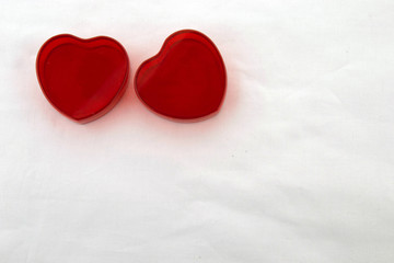 Valentines day! Two small heart-shaped boxes for a gift, isolated on a white background.