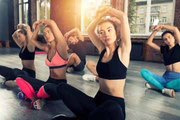 Young people do stretching at the gym