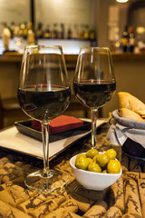 Wine with olives and bread tapas in bar, Malaga, Spain