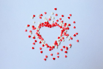 Valentine day background with red and white hearts, top view