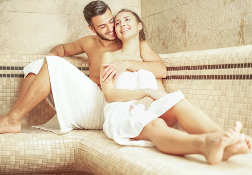 Young couple relaxing inside spa sauna room - Romantic lovers enjoying vacation day doing body treatment in luxury resort hotel - Relationship, relax, recreation and wellness lifestyle concept