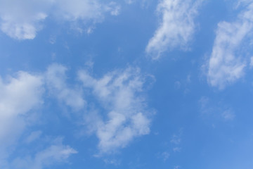 The blue sky and white clouds indicate pure and freshing