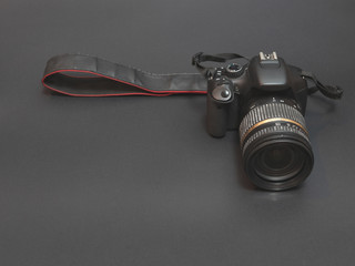 low angle shot of professional photo camera. low key image. concept of electronic photographic equipment store department
