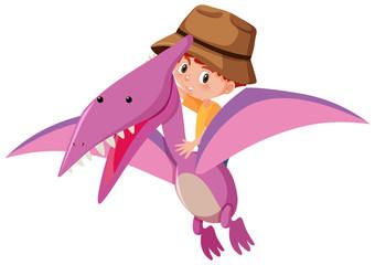 A boy riding dinosaur
