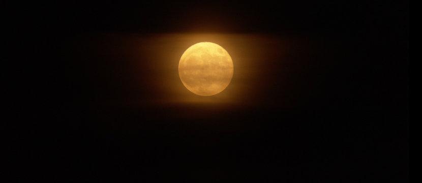Close up of foggy yellow moon