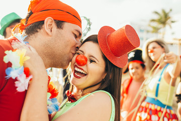 Brazilian Carnival. Couple in costume enjoying the carnival party in the city
