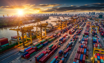 Container ship in import export and business logistic, By crane, Trade Port, Shipping cargo to harbor, Aerial view from drone, International transportation, Business logistics concept Wall mural