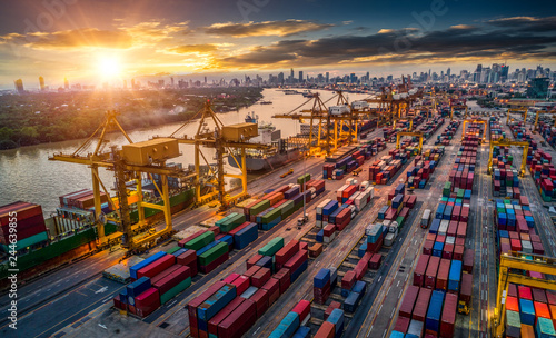 Wall mural Container ship in import export and business logistic, By crane, Trade Port, Shipping cargo to harbor, Aerial view from drone, International transportation, Business logistics concept