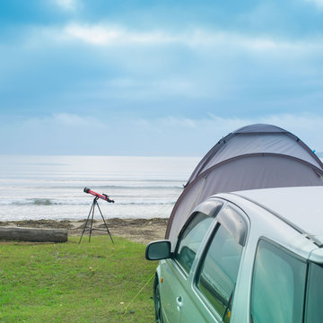 Seascape summer travel machine tent rubber boat Coastline horizon sky with clouds