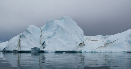 Global Warming and Climate Change - Giant Iceberg from melting glacier in Ilulissat, Greenland. Imageof arctic nature landscape famous for being heavily affected by global warming.