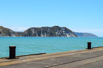 Coastal land near the pier in Tolaga Bay, New Zealand.