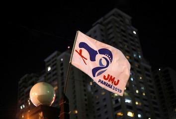 A flag with the logo of World Youth Day waves outside a church in Panama City, ahead of Pope Francis' visit for World Youth Day in Panama City