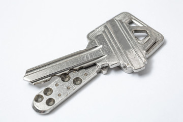 Close up of Silver key on white background