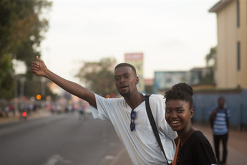 Young couple hailing for a taxi