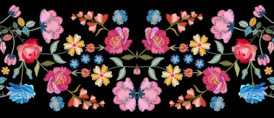 Colorful seamless embroidery border with beautiful flowers. Floral embroidered pattern on black background. Fashion print.