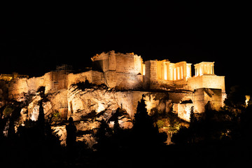 People silhouettes in the foreground, with Acropolis night view at the background