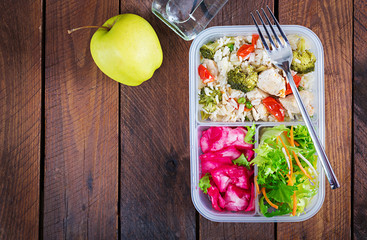 Lunch box  chicken, broccoli, green peas, tomato  with rice and red cabbage. Healthy fitness food. Take away. Lunchbox. Top view
