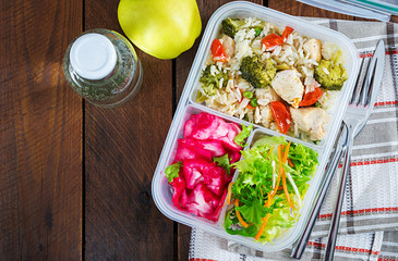 Fotobehang Assortiment Lunch box chicken, broccoli, green peas, tomato with rice and red cabbage. Healthy fitness food. Take away. Lunchbox. Top view