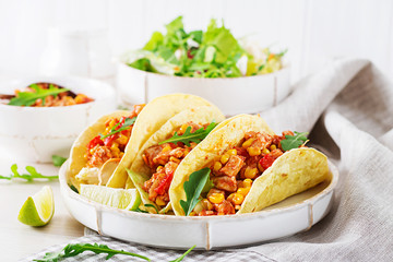 Mexican tacos with chicken meat, corn and tomato sauce. Latin American cuisine. Taco, tortilla, wrap.