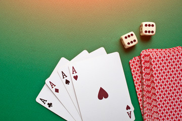 Chips, poker playing cards and dice on the green table. Poker game concept.