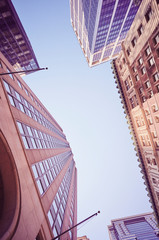 New York buildings, look up perspective, color toning applied, USA.