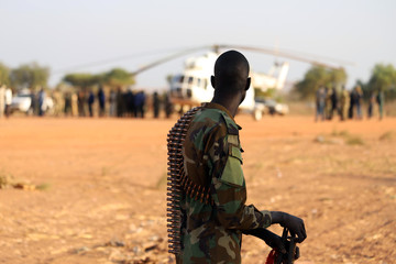 An armed member of the South Sudanese security forces is seen during a ceremony marking the restarting of crude oil pumping at the Unity oil fields