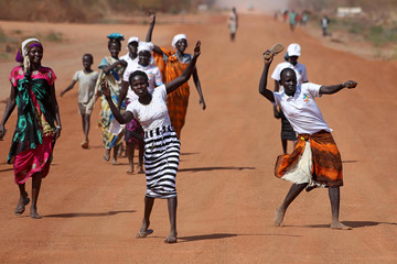South Sudanese women dance during a ceremony marking the restarting of crude oil pumping at the Unity oil fields in South Sudan