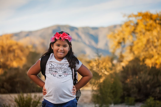A pre teen female student wearing a backpack during a school field trip in California.