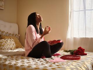 romantic scene of african american woman enjoying valentines day chocolates