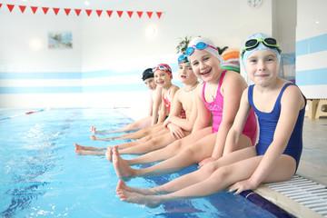 little kids swimming  in pool