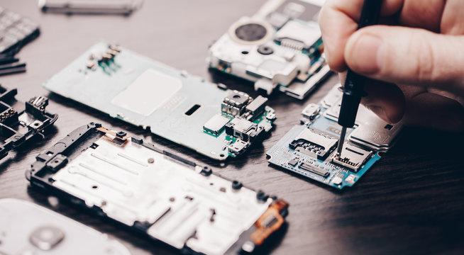 mobile phone repair, hands closeup