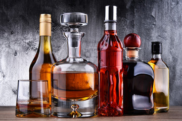 Acrylic Prints Bar Carafe and bottles of assorted alcoholic beverages.