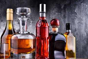 Carafe and bottles of assorted alcoholic beverages. Fototapete