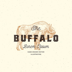 The Buffalo Abstract Vector Sign, Symbol or Logo Template. Hand Drawn Bison Sketch Illustration with Retro Typography. Vintage Emblem with Press or Stamp Effect.