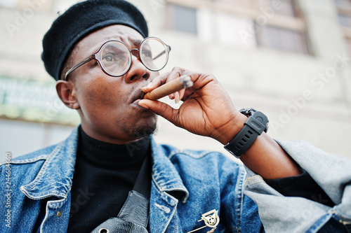 a80be11868670 Close up portrait of african american man in jeans jacket