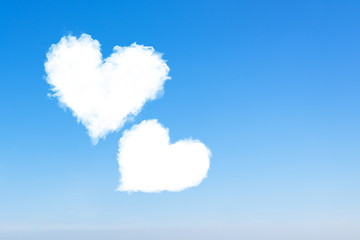 Loving couple of clouds are flying in the blue sky